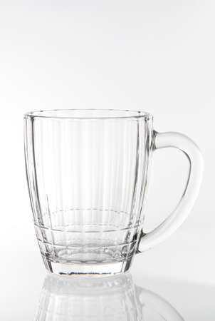 empty glass of draft beer isolated on white background