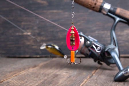 Fishing spinner spoon lure on fishing spinning reel 스톡 콘텐츠