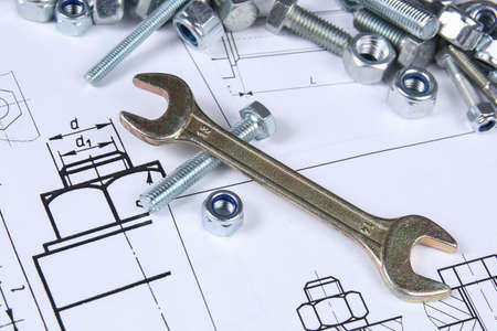 Wrench, bolts and nuts. Science, mechanics and mechanical engineering Imagens