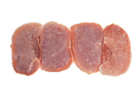 pieces of raw meat steaks on a white background