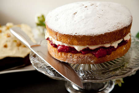sideboard: Victoria sponge cake on glass plate