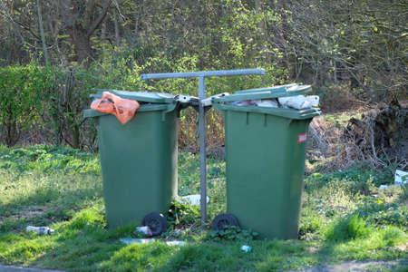 Overflowing garbage bins photo