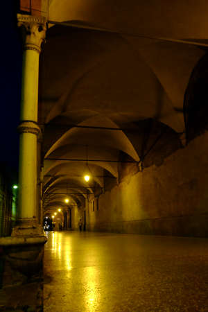 passageway: Bologna portico at night light at the end of the tunnel