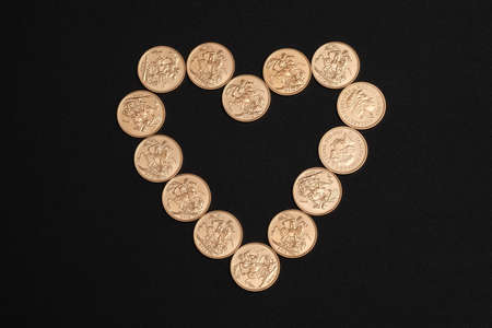 sovereign: Gold sovereign coins in heart shape