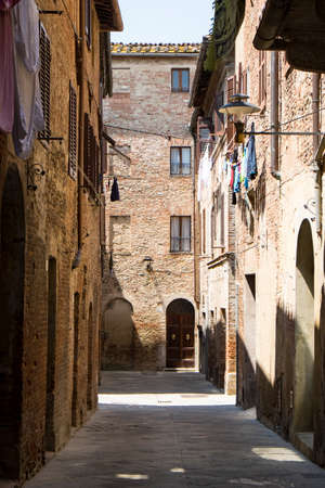 midday: Buonconvento passageway,  Tuscan town at midday Stock Photo