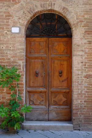 fanlight: Old wood doorway with brick surround Stock Photo