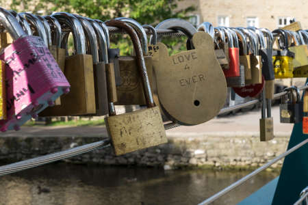 inscribed: Love forever inscribed on a big padlock on bridge