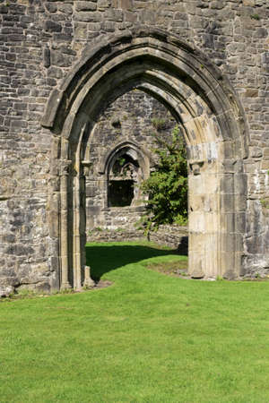abbey ruins abbey: Stone archway in abbey ruins Stock Photo