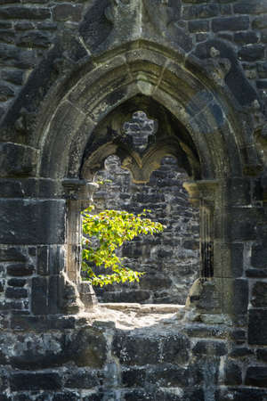 crumbling: crumbling gothic window arch at Whalley Abbey