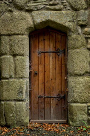 unaffected: Old door with spider webs in stone wall Stock Photo