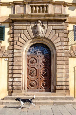 fanlight: Ornate carved door in stone surround