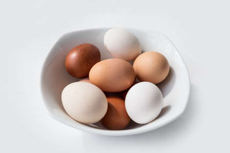 free dish: Bowl of brown and white eggs