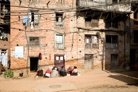 shanty: Nepalese ladies sitting outside homes