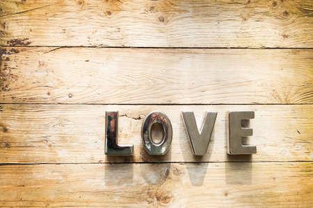 Liefde op houten achtergrond Stockfoto