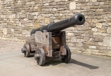 cannon gun: Old cannon on wooden gun carriage Stock Photo