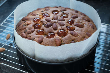 Homemade dundee fruit cake cooling