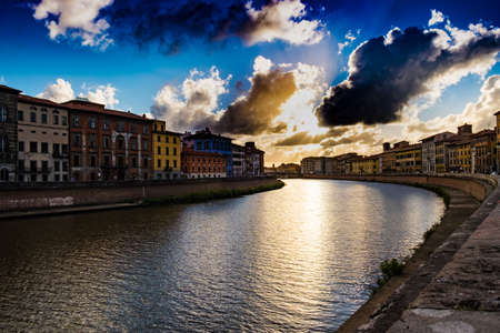 Dramatic sky over river Arno at Pisa