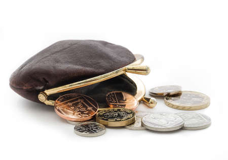 Loose change with an open purse. British coins including the new pound coin introduced in 2017.