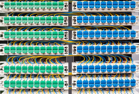 Broadband landline routing equipment, color coded neat wiring.