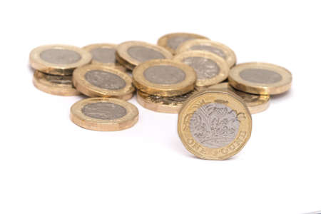 UK money, pile of british sterling pound coins on white background