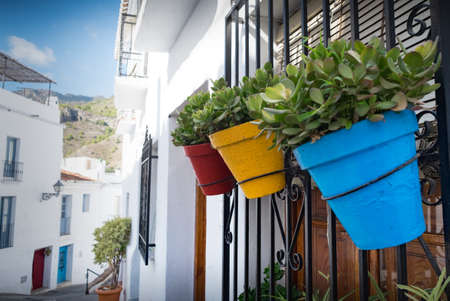 Colorful plantpots outside village house in Frigilana Stock Photo