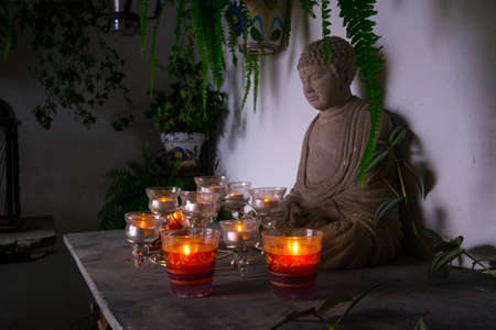 Buddha shrine with candles Editorial