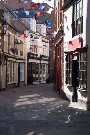 Quaint english street with georgian and victorian shops, Whitby, UK