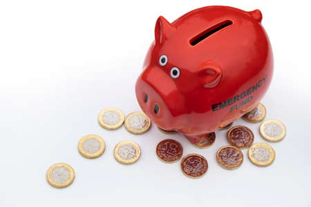 UK money crisis, piggy bank with pound coins 版權商用圖片