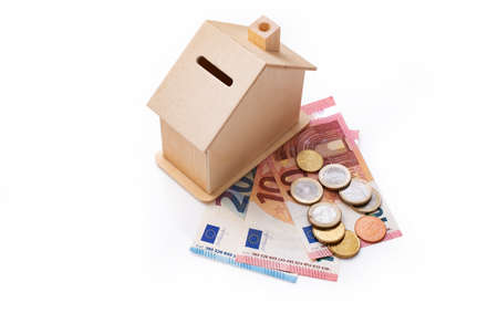 Money box house with euro money, savings or mortgage concept