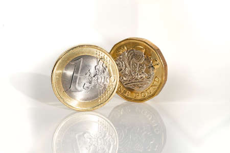 Euro coin and pound coin, the basic currency units of the EU and the UK