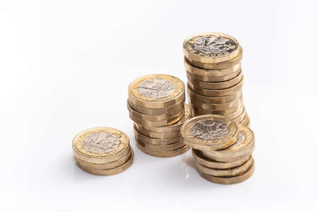 stacks of british pound coins, english money