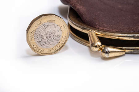 UK money, pound coin next to purse Stock Photo