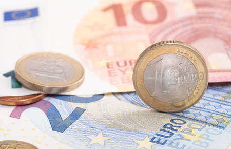 Euro money close-up, image includes coins and banknotes Stock Photo