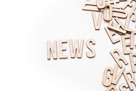 News concept, word spelled out in wooden letters