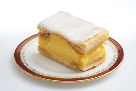 Vanilla slice, a popular cake in the UK and Europe on a plate, made of confectioners custard, flaky pastry and icing