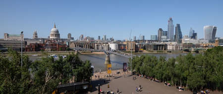 City of London, United Kingdom 6th July 2019: London skyline panorama seen from south bank, St Pauls Cathedral and river Thames in foreground on summer day