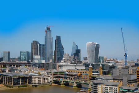 City of London, United Kingdom 6th July 2019: London skyline seen from south bank, river Thames in foreground on summer day
