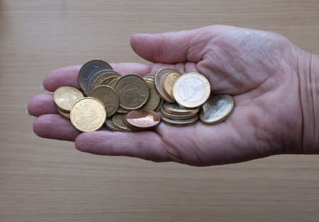 Hand holding lots of euro coins, the currency of the EU Stock Photo