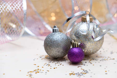 Christmas background, glitter baubles against soft pink background Stock Photo