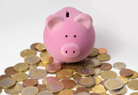 Piggy bank saving box on top of euro coins, interest and growth concept Stock Photo