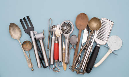 Cooking utensils, mixed vintage cookery and baking cutlery and tools Stock Photo