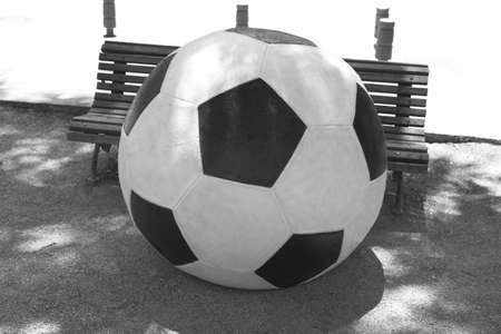Soccer ball disguise on a street black and white photo
