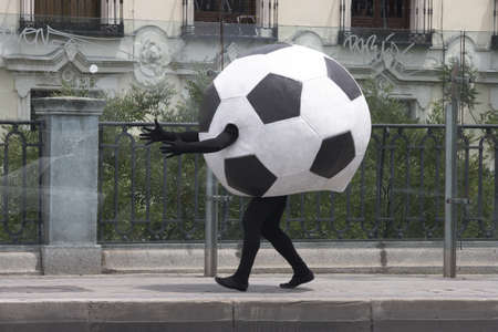 delirious: Soccer ball disguise on a street black and white Stock Photo