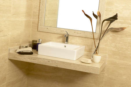 Basin with soap and towels in a bathroom photo