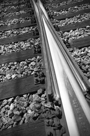 Components and assemblay system of old rails black and white vertical photo