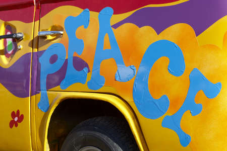 Colorful peace graffiti on a vehicle horizontal  photo
