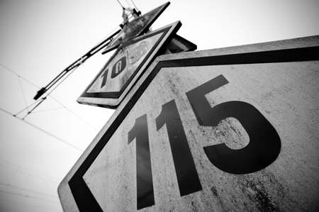 locomotion: Speed limit railway signpost perspective black and white vignetting