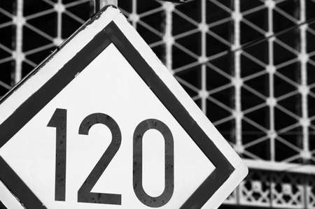 Speed limit railway signpost perspective on top black and white Stock Photo - 18466758