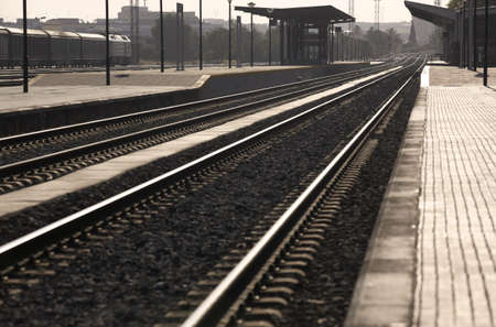 locomotion: Railway station platforms and rails at sunset Stock Photo