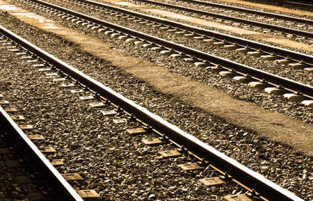 locomotion: Railways sleepers and stones with bright of the Sun on the rails perspective. Stock Photo